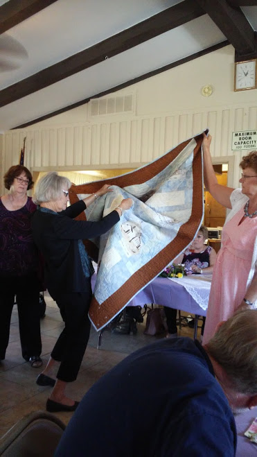 Reading the Names of the Creators of the Quilt